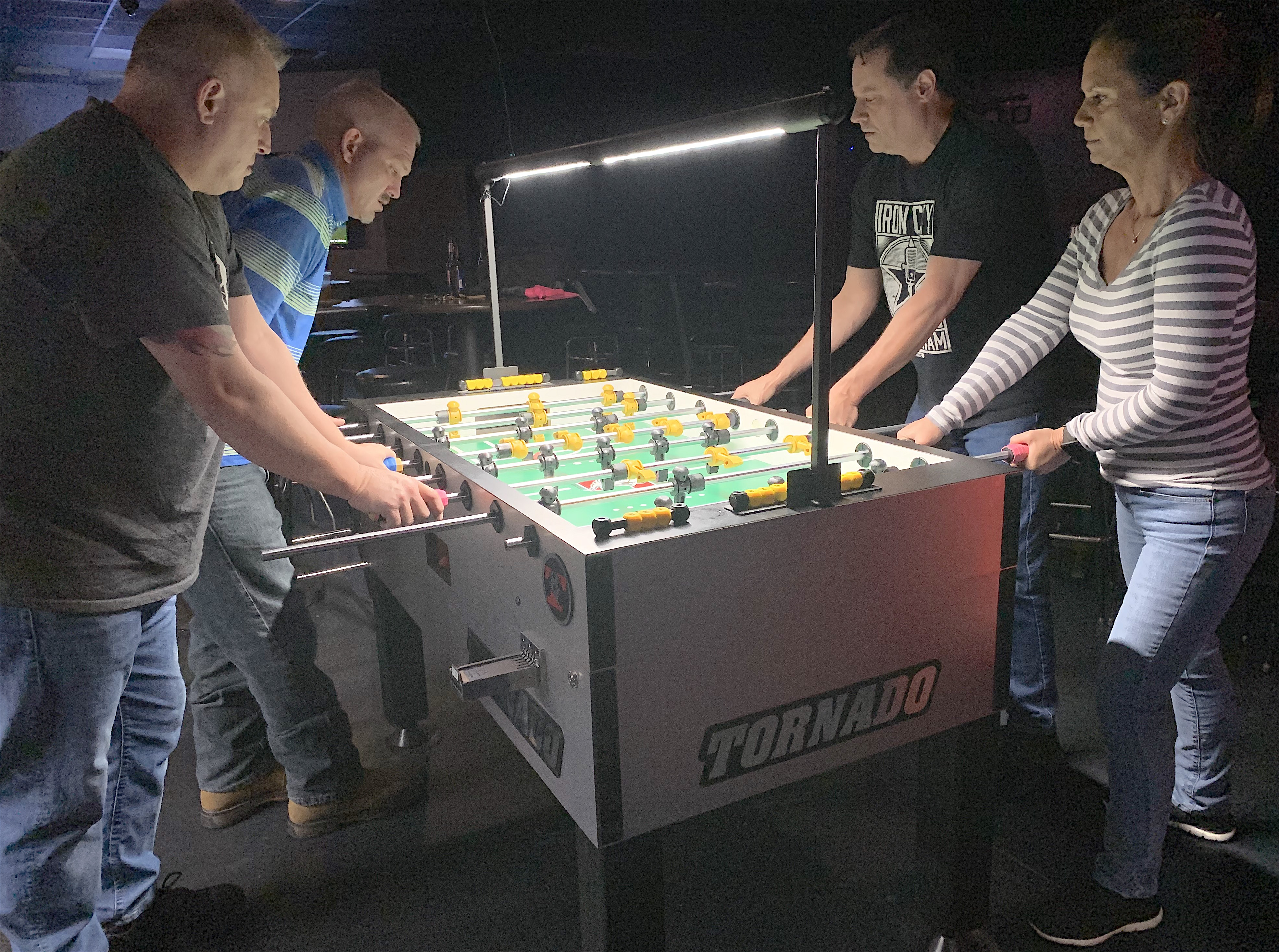 Pictured is Chuck Shikle & Jeremy Monroe vs James Porter & Cheryl Lowe during 2019 foosball tournament action at Madison Station in North Alabama.