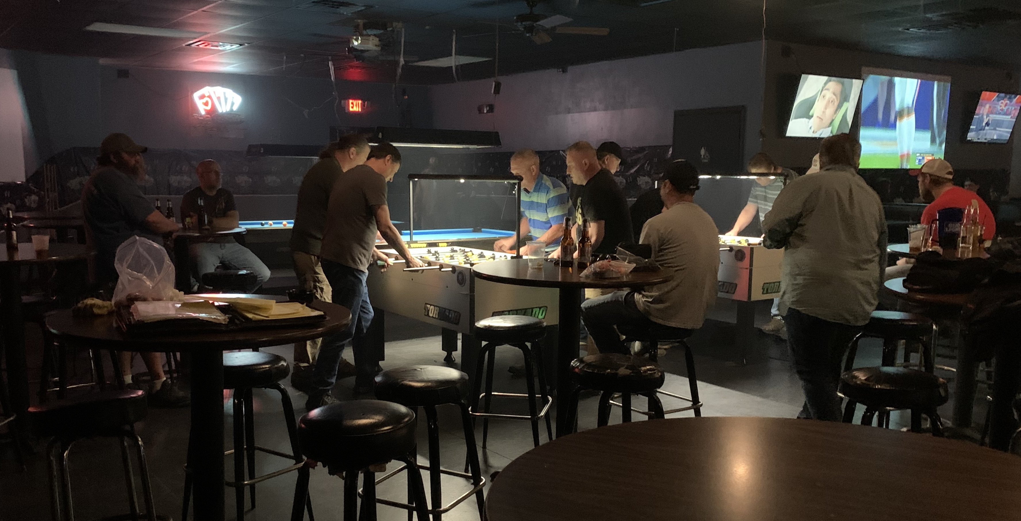 Shown in Madison,AL. playing a weekly foosball tournament at